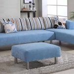 Sweet blue sectional sofa with chaise a blue Ottoman furniture stripped throw pillows gray fluffy rug