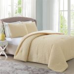 soft beige bed comforter set with pure white bed sheet
