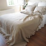 white bed skirt with beige bed comforter