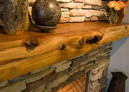 Elegant Firepit with Unpolished Panel of Oak Wood using Ornamental Decoration on Shelf and Rustic Brick Installation as Decoration of Fireplace