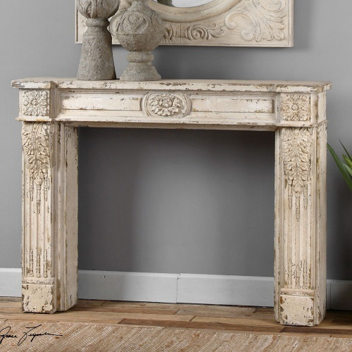 Modest Fireplace Mantel Made of Oak Wood Painted in White with Several Accents to Combine Ornamental Design with Mirror on Accet Frame