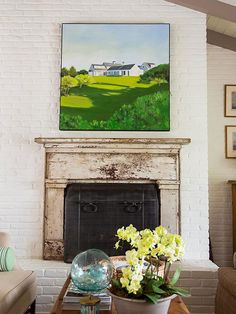 Delightful Fireplace with Ornamental Accent on White Concrete Wall Painted in White Combining Landscape Paintings and Steel Panel for Mantel