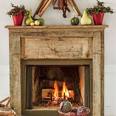 Authentic Wooden Fireplace with Rustic Model for Mantel and Fruits Decoration as Main Ornaments of Fireplace with Transparent Panel on Fire Circulation
