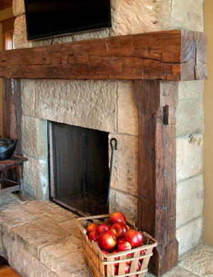 Fancy Fireplace with Cracked Model of Stone Installed on Floating Panel with Rustic Model of Firepit using Glossy Finishing to Embrace White Accent of Wall