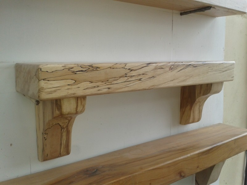 Enchanting Fire Shelf made of Oak Wood with Unpolished Finishing and Stable Wood Installed on White Concrete Wall of Minimalist House