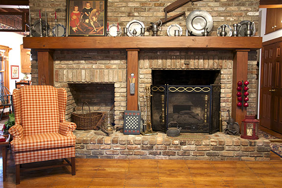 Fascinating Fireplace with Rustic Model of Stone Mantel also Wooden Firepit and Rustic Model of Longue Sofa as Nook Area in Classic House