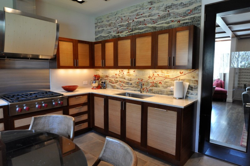 Asian themed kitchen with floral patterned back splash and grey details glossy white countertop flat panel cabinets stainless steel square sink and faucet tiles floors stainless steel appliances