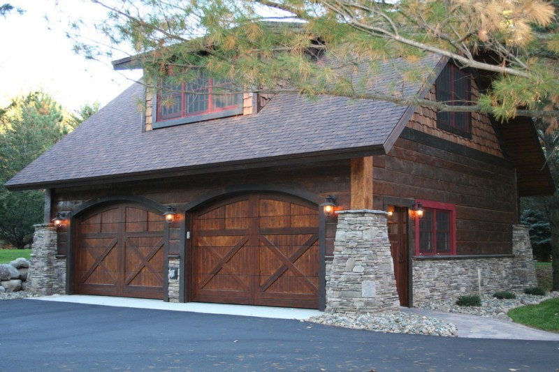 Mediterranean Rustic garage door entrance with dark wood frame and double X decorations