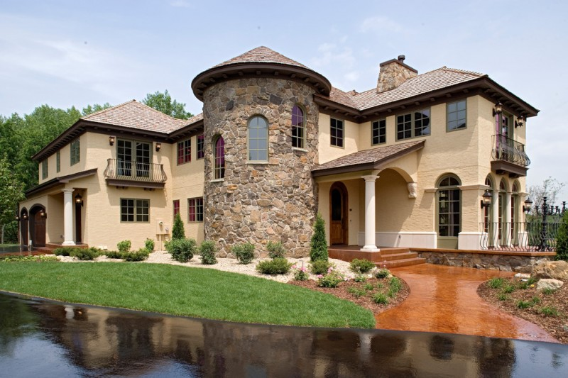 Tuscan costum house idea with random patterned stone walls high and curved doors and windows dark glass windows beautifulfront yard