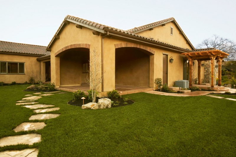 Tuscan house idea with beige stucco walls and floors terracotta roofs large green front yard