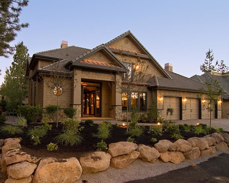Tuscan style home idea with flat stone wall system copper roof details dark beige roof system deep beige siding idea