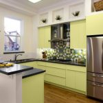 U Shape Contemporary Kitchen With Fresh Yellow Cabinets Black Dove Countertop And Double Layers Island Stainless Steel Appliances Flower Shaped Backplash In Multicolor Medium Tone Wooden Floors