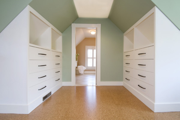 angled walk in closet with slanted ceiling on top white cabinets white open shelves