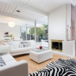 Bottom To Top White Brick Fireplace Installation With Earthy Wood Color Frame And Glass Cover