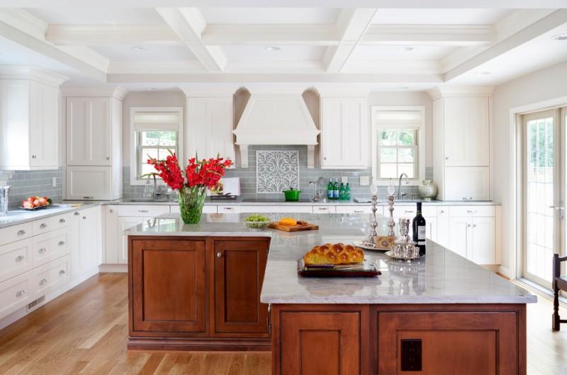 bright & elegant L shape kitchen idea with gloss & white top island gloss & white countertop grey subway tiles backsplash simple white cabinets medium tone wood floors