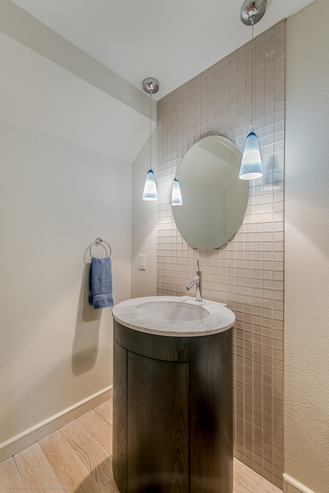 cone shaped vanity model with rounded white basin and faucet round and frameless vanity mirror a couple of hanging lamps