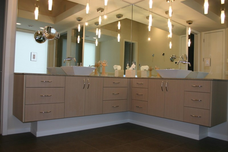 contemporary floating corner vanity design with white free standing sinks