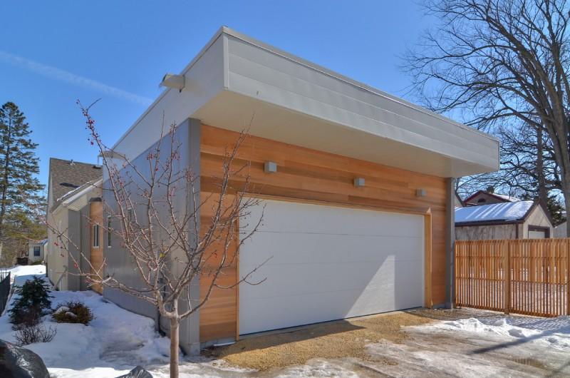contemporary garage idea with pure white minimalist entrance