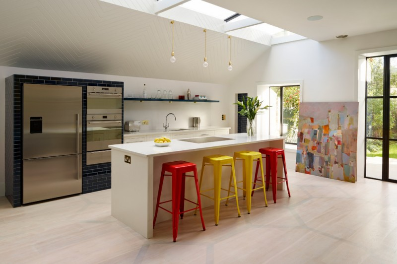 contemporary open kitchen with attractive handmade stools and simply cream breakfast bar