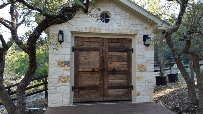 custom cedar garage door with iron hingers rustic limestoned car garage