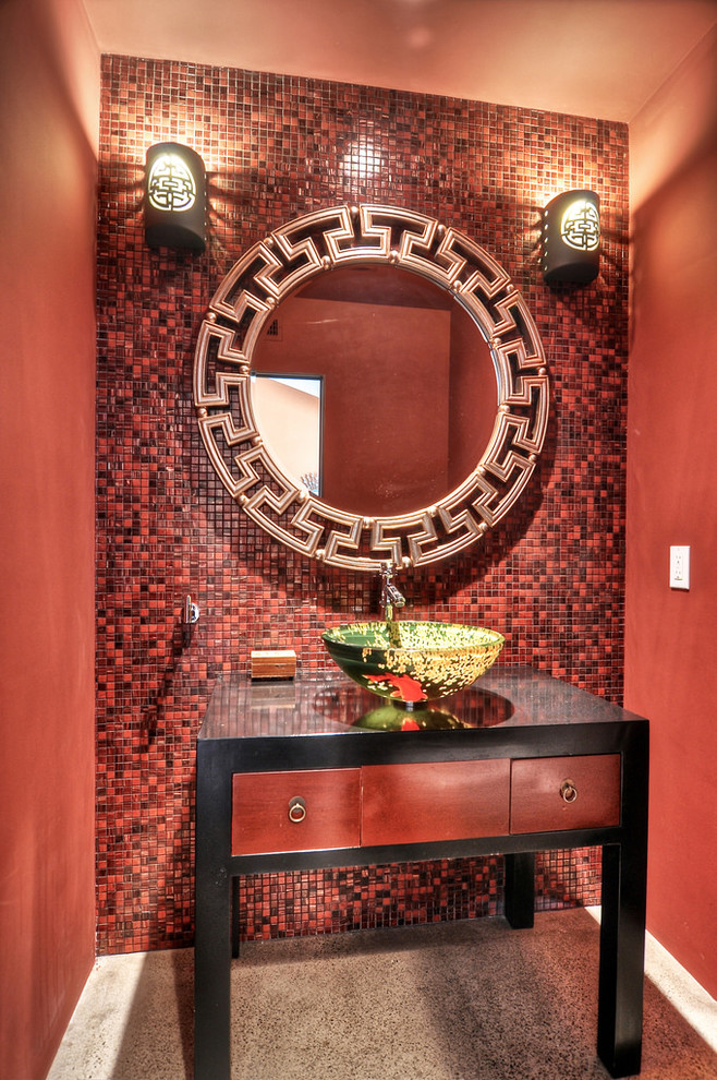 luxurious red bathroom vanity with drawer system and black top & frame rounded vanity mirror with luxurious metal frame red toned and textured wall system