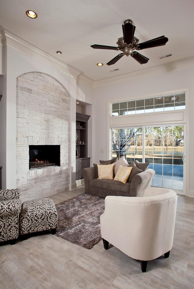 mediterranean white brick fireplace a set of furniture in multicolor dark ceiling fan animal skin rug whitewash floor system