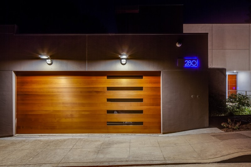 modern minimalist garage door with small glass window panels offset to right side of garage