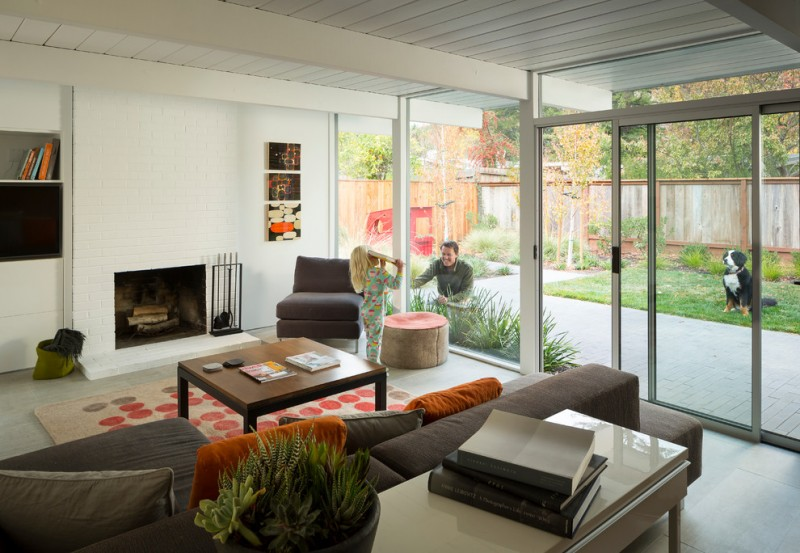 modern minimalist white brick fireplace that is integrated with wall system