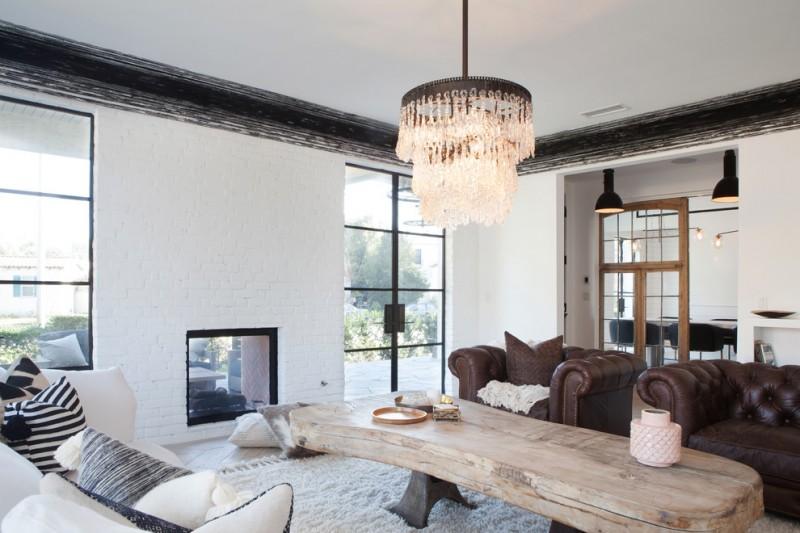 modern vintage white bricks fireplace idea with black frame white fury rug tree center table idea brown leather sofa
