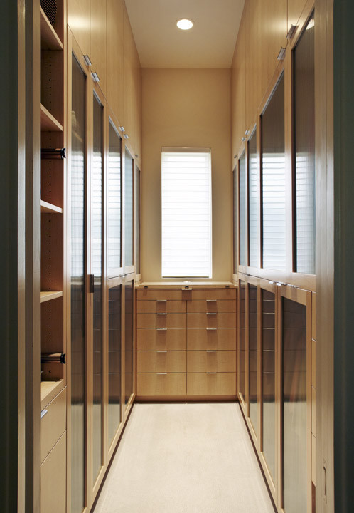 modern walk in closet idea with cedar finish and dark glass panel as the cabinets' doors medium size rectangular mirror without frame cedar drawer system