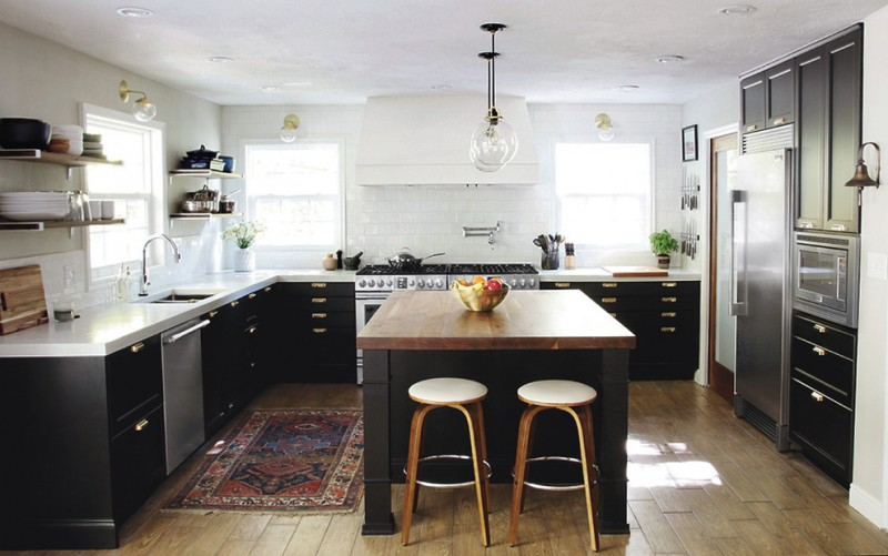 monochromatic kitchen idea white kitchen countertop with black base white tile backsplash wooden slab flooring system hardwood top island round top bar stools black cabinets