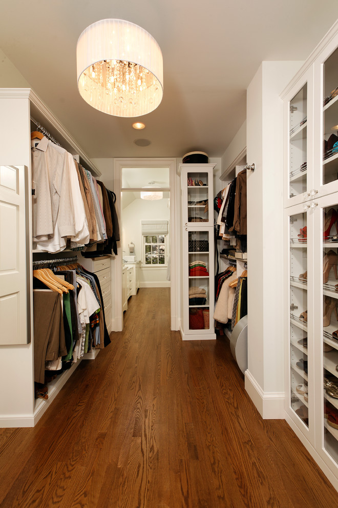 narrow walk in closet idea with white cabinets glass door storage hang sections for clothes large crystal chandellier with creame shade