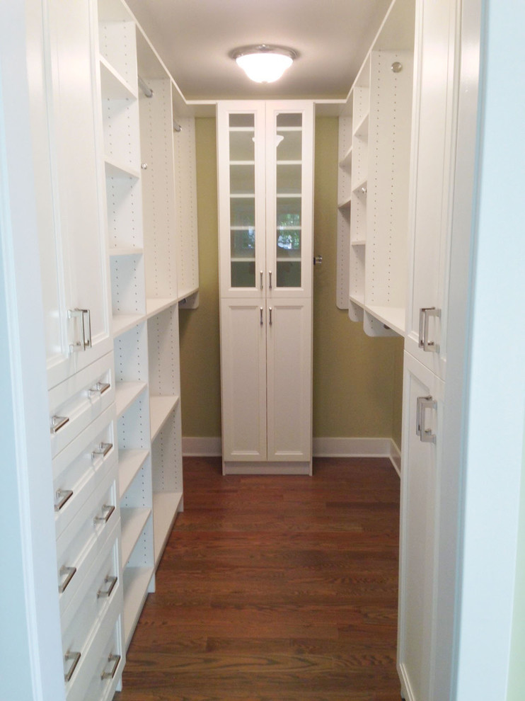 narrow yet stylish walk in closet with white finishing and closet system