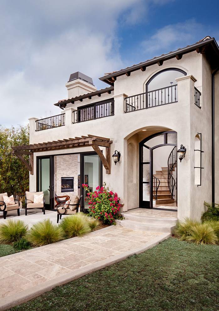 pale stucco house in Tuscan style