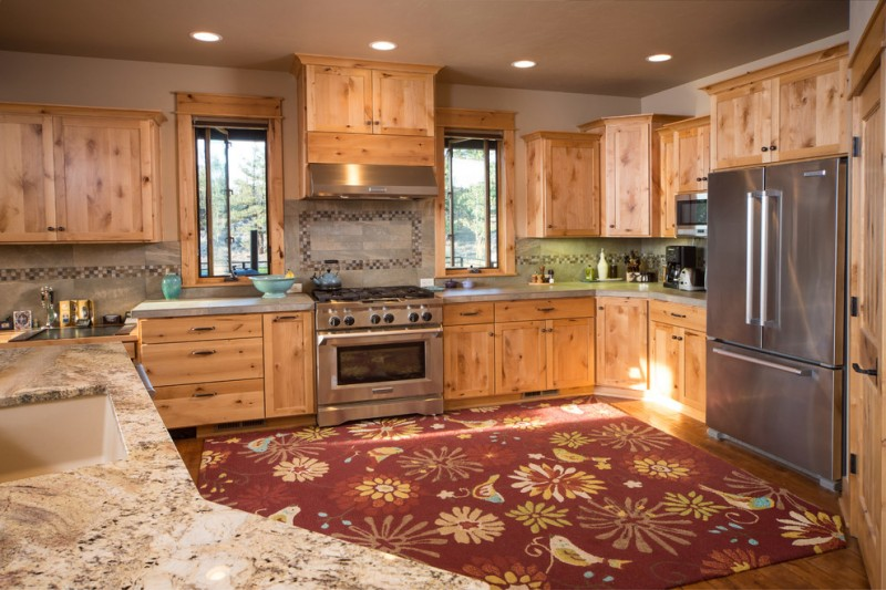 ranch home kitchen idea wooden cabinets grey granite countertop kitchen rug with nature pattern grey subway tiles with black pattern stainless steel appliances
