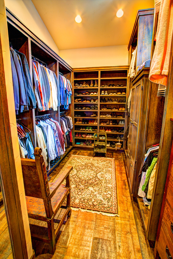 rustic walk in closet idea large shoes rack flat panel cabinets upper and lower hang sections for clothes ottoman rug hardwood floors without finishing traditional wooden chair