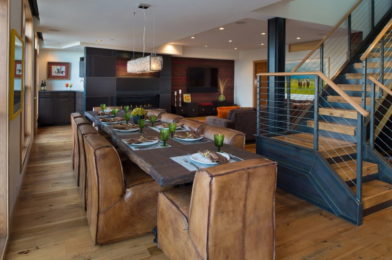 solid rustic dining room and kitchen idea shaby but stylish leather dining chairs shaby but beautiful dining table dark toned wood slab walls solid black cabinets