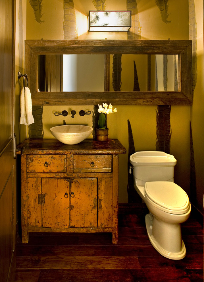 stylish cabin's restroom with Western lifestyle single white toilet shabby but stylish bathroom vanity with cabinets white vessel wood framed rectangular vanity mirror modern vanity lights