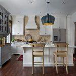 Traditional Open Kitchen Idea White Island Stainless Steel Appliances White Countertop Multicolor Backsplash Dark Hardwood Flooring System Grey Dishware Storage Black Dove Pendant Lamp