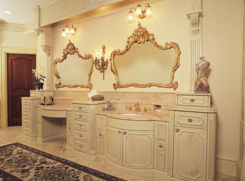 traditional victorian style vanity bathroom with couple of luxurious mirrors and lamps