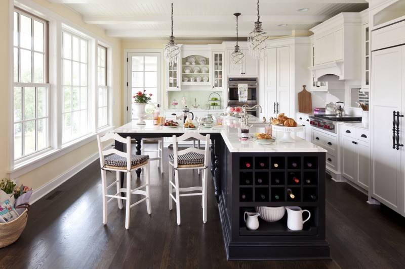 transitional L shape kitchen design with L shape island integrated with wine storage and breakfast bar white shaker cabinets dark tone wood floors stainless steel appliances