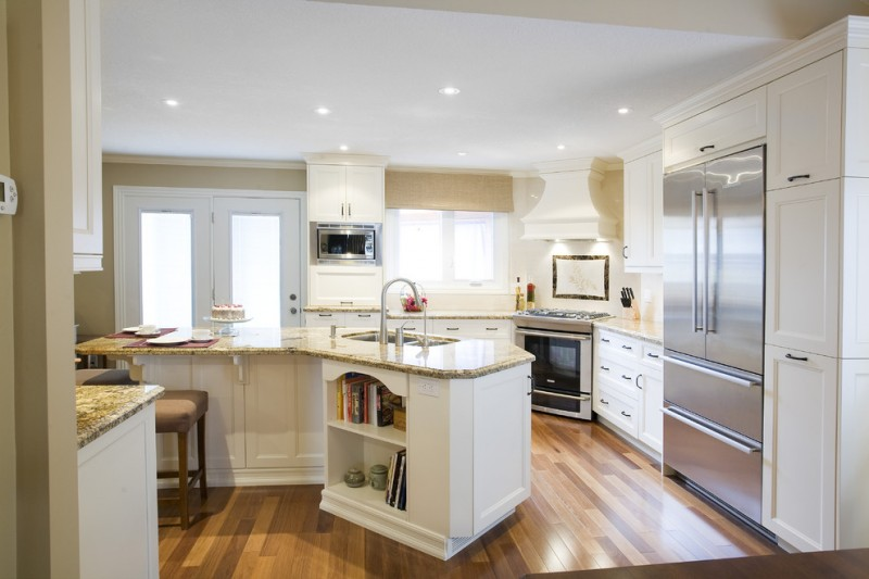 transitional kitchen design with angled and L shaped kitchen countertop angled kitchen island white cabinets gloss wood slabs flooring idea stainless steel appliances