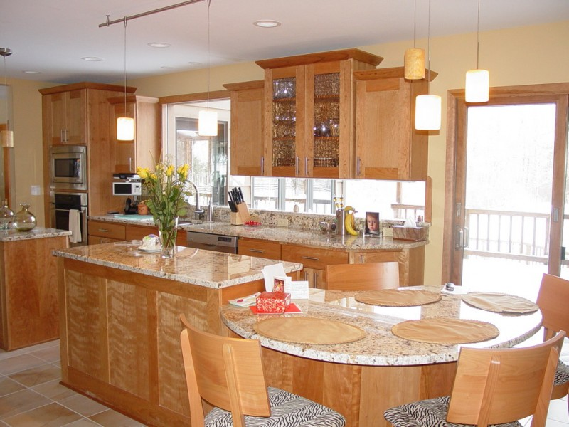unique and stylish L shape kitchen idea with glass window backsplash glass front top cabinets granite countertop double islands modern pendant lamps zebra printed cushions