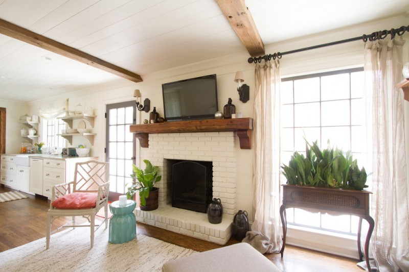 white bricks fireplace with wall mounted TV