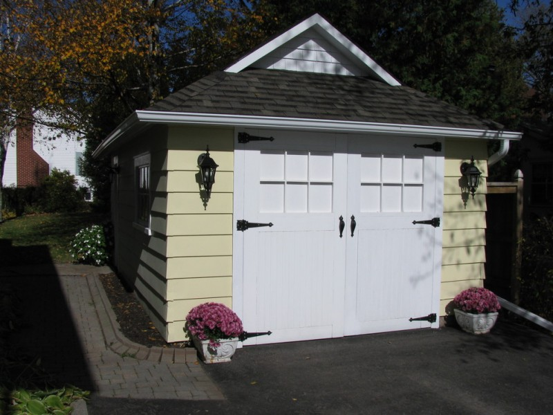 white garage door idea with light cream farmhouse shed
