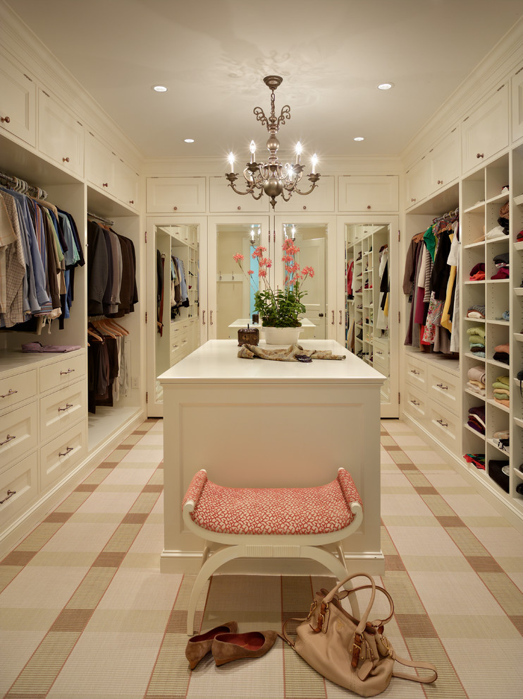 white melamine walk in closet idea white cabinets white center tables red top chair chandelier ceramic floors with patterns
