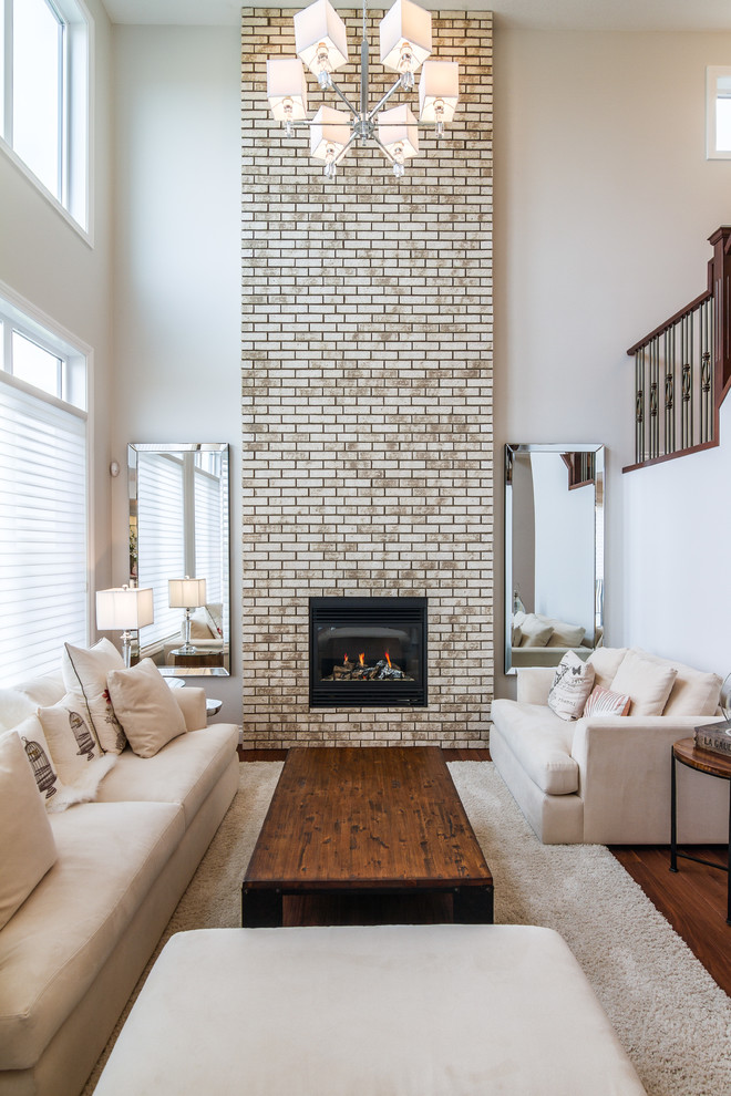 whitewash brick fireplace building with black frame beige sofas with accent pillows soft fury rug rustic coffee table modern pendant lamp