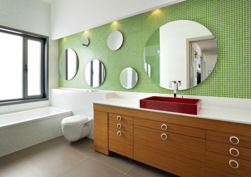 wood colored vanity ideas with white surface and dark red sink rounded and frameless mirrors green and textured wall system