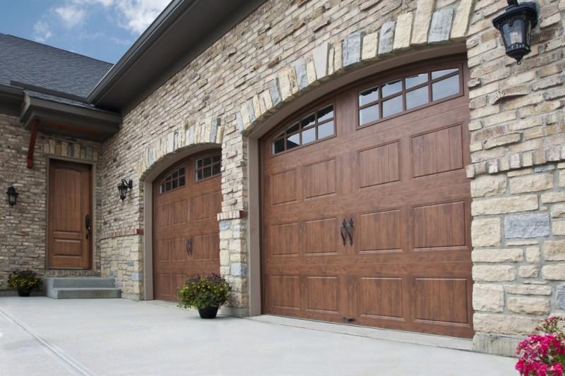 woodgrain veneer garage door with dark metal handles