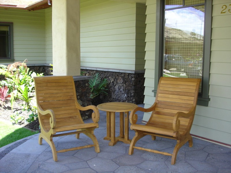 Hawaiian style front porch idea custom wood chairs and table concrete paving floors